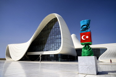 HMS2102880 Azerbaijan, Baku, Heydar Aliyev cultural center futuristic monument designed by the architect Zaha Hadid and sculpture of the Azerbaijan national flag as candy figure by French artist Laurence Jenkell