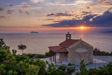 HMS3113609 Greece, Crete, Heraklion district, surroundings of Matala, Messara bay at sunset, Agios Panteleimona church overlooks Kommos (or Komos) beach