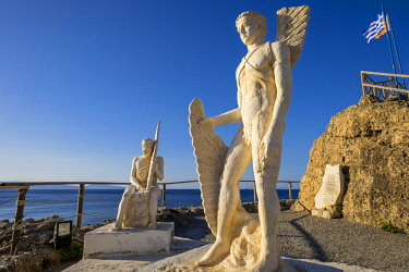 HMS2874881 Greece, Crete, Messara bay, Agia Galini, statues of Icarus and Daedalus ready to fly to escape King Minos