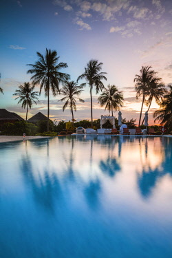 MIV0410AW Palms reflecting in swimming pool at sunset, Maldives