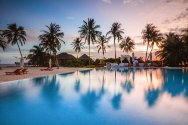 MIV0411AW Palms reflecting in swimming pool at sunset, Maldives