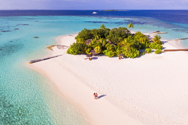 MIV0421AW Aerial drone view of adult couple on a sandy beach, Maldives (MR)