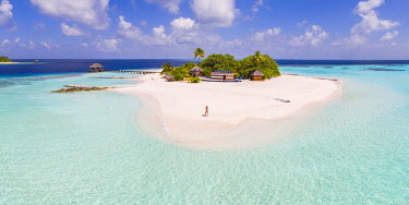 MIV0424AW Aerial drone view of woman on a sandy beach, Maldives (MR)