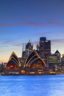 AUS2992AW Sydney Opera House and skyline at sunset, Sydney, New South Wales, Australia