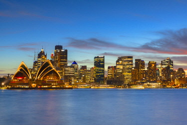 AUS2998AW Sydney Opera House and skyline at sunset, Sydney, New South Wales, Australia