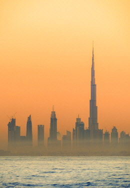 UAE0494AW City Centre Skyline seen from Palm Jumeirah artificial island at sunrise, Dubai, United Arab Emirates