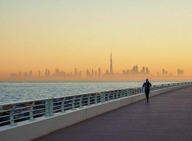 UAE0583AW Palm Jumeirah Boardwalk and City Centre Skyline at sunrise, Dubai, United Arab Emirates