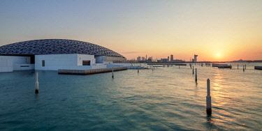 UAE0615AW Louvre Museum at sunset, Abu Dhabi, United Arab Emirates