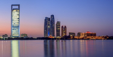 Skyline with Etihad Towers at dawn, Abu Dhabi, United Arab Emirates