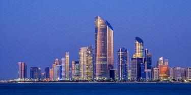 UAE0623AW Skyline of the city center at twilight, Abu Dhabi, United Arab Emirates