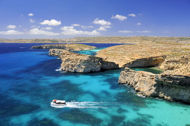HMS3119696 Malta, Comino Island, Comino, Blue lagoon and Cristal Lagoon, boat in the lagoon