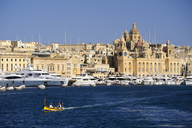 HMS3119711 Malta, Birgu Vittoriosa, Dockyard Creek between Senglea and Vittoriosa, boats including a colorful luzzu in front of the Maritime Museum