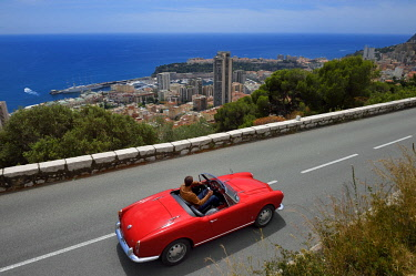 HMS2088651 Principality of Monaco, collection convertible Alfa Romeo Giulietta on the Moyenne Corniche road overlooking Monaco (Compulsory mention: Company Rent a Classic Car)