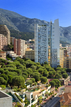 HMS2088725 Principality of Monaco, Monaco, La Condamine district, Princesse Antoinette park and the Simona building designed by architect Jean Pierre Lott