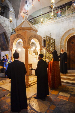 ISR0321 Israel, Jerusalem. The Armenian Orthodox ceremony in front of the marble canopy marking the Station fo the Holy Women as part of the Sunday celebrations at the Stone of the Anointing or Stone of Uncti...