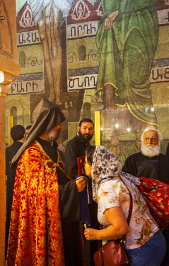 ISR0322 Israel, Jerusalem. The Armenian Orthodox ceremony in front of the marble canopy marking the Station fo the Holy Women as part of the Sunday celebrations at the Stone of the Anointing or Stone of Uncti...