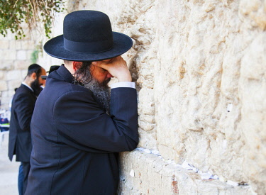Israel, Jerusalem. An Orthodox Jew praying at the Western Wall.