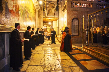ISR0316 Israel, Jerusalem. The Armenian Orthodox ceremony as part of the Sunday celebrations at the Stone of the Anointing or Stone of Unction at the entrance of the Church of the Holy Sepulchre.