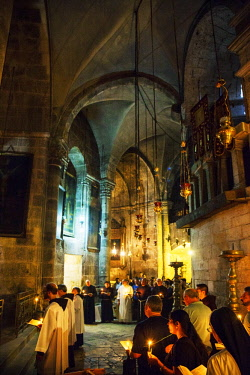 ISR0310 Israel, Jerusalem. Roman Catholics praying at one of the chapels during the Sunday ceremony at the interior of one of the most important Catholic Churches in the World, the Church of the Holy Sepulchr...