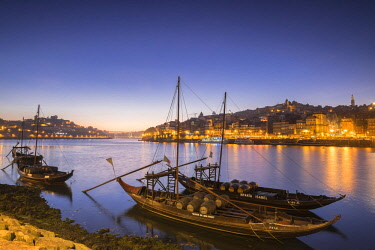 HMS2255142 Portugal, North region, Vila Nova de Gaia, rabelos boats, typical boat that was once used to transport barrels of port wine, the historic center of Porto listed as World Heritage by UNESCO, in backgro...
