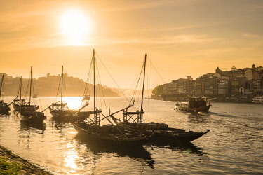 HMS2255188 Portugal, North region, Vila Nova de Gaia, rabelos boats, typical boat that was once used to transport barrels of port wine, the historic center of Porto listed as World Heritage by UNESCO, in backgro...