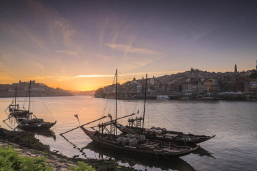 HMS2255210 Portugal, North region, Vila Nova de Gaia, rabelos boats, typical boat that was once used to transport barrels of port wine, the historic center of Porto listed as World Heritage by UNESCO, in backgro...