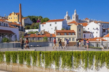 HMS2858425 Portugal, Lisbon, view over the rooftops of the Alfama district and Sao Vicente de Fora monastery from the terrace of Largo das Portas do Sol