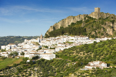HMS2653481 Spain, Andalucia, Cadix province, Zahara de la Sierra, Sierra de Grazalema Natural Parc, high angle view of the village, the tiled roof, San Juan de Letran chapel and the medieval tower above the vill...