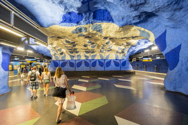 HMS3179698 Sweden, Stockholm, Norrmalm district, T Centralen metro station with a background dating back to 1975 by the artist Per Olof Ultvedt