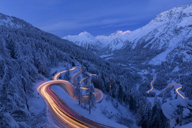 CLKRM76786 Car lights on the hairpin bends at night, Maloja Pass, Engadin, canton of Graubunden, Switzerland