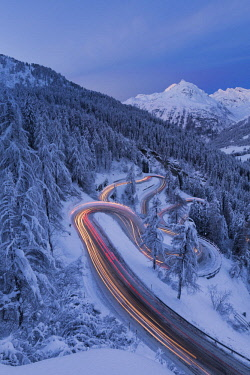 CLKRM76789 Car lights on the hairpin bends at night, Maloja Pass, Engadin, canton of Graubunden, Switzerland