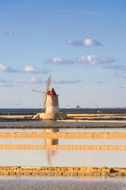 CLKGA75460 Salt pans with rows of tanks and a fully functional windmill on the coast connecting Marsala to Trapani, Trapani province,Sicily,Italy