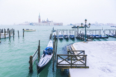 ITA11977AW Gondolas with snow at St Mark's waterfront, Venice, Veneto, Italy.