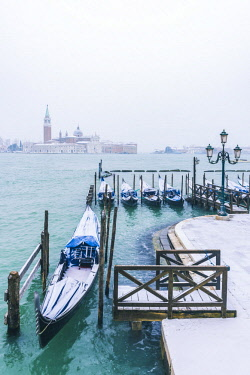 ITA11978AW Gondolas with snow at St Mark's waterfront, Venice, Veneto, Italy.