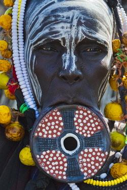 AF16KSU0299 Mursi tribe, people with lip plate, Mursi Village, South Omo, Ethiopia
