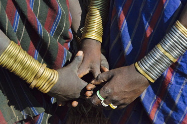 AF16KSU0302 Mursi tribe, people in traditional clothing wearing bracelets, Mursi Village, South Omo, Ethiopia