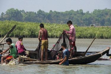 AS03CMI0020 Bangladesh, Chittagong, Bay of Bengal near Maheshkhali Island (aka Mahesh Khali) Fishermen using traditional wooden fishing boat.