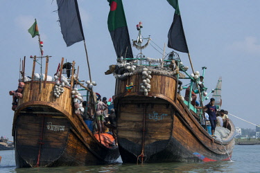 AS03CMI0022 Bangladesh, Chittagong, Bay of Bengal near Maheshkhali Island (aka Mahesh Khali) Fishermen using traditional wooden fishing boats.