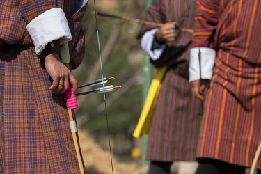 AS04CMI0038 Bhutan, Thimphu, capital of Bhutan. Local archery competition played in traditional Gho, national dress for men. Most popular sport in Bhutan and the National Sport.
