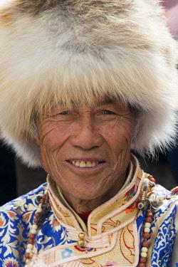 AS07KSU1841 Jiarong Tibetan man in traditional clothing, Jinchuan, Sichuan Province, China