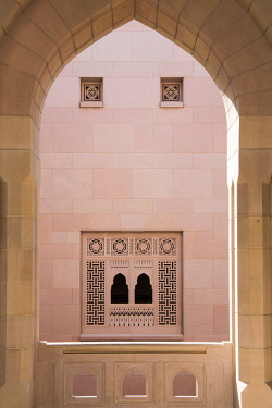 OMA2758 Middle East, Oman, Muscat.  An arched window looking out of one of the open-air arcades in The Sultan Qaboos Grand Mosque