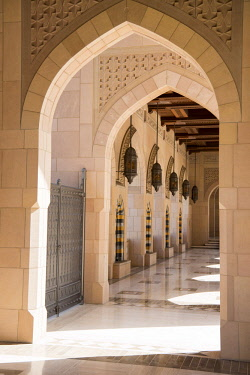OMA2767 Middle East, Oman, Muscat.  Arched, open-air arcades surround the main building of The Sultan Qaboos Grand Mosque