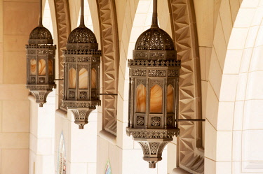 OMA2819 Middle East, Oman, Muscat.  Brass lanterns in the colonnade of The Sultan Qaboos Grand Mosque