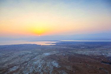 ISR0397 Israel, Dead Sea, Masada. Dawn over the dead sea from atop Masada with sediments from the ancient dead sea.