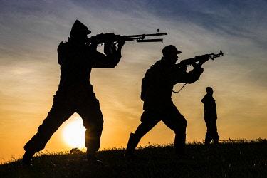 UGA1531AW Uganda, Bwindi Impenetrable National Park, Nkuringo Village. Armed rangers training near  Nkuringo village bordering Bwindi Impenetrable Forest.
