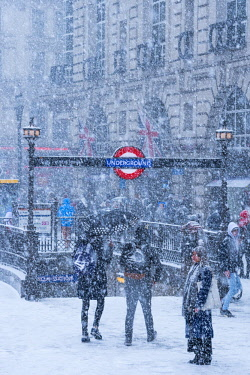 UK11383 UK, England, London, The West End, Piccadilly Circus, Underground Station entrance,snow storm