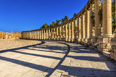 AS16WPE0065 Oval Plaza, 160 Ionic Columns, Jerash, Jordan. Jerash came to power 300 BC to 100 AD and was a city through 600 AD. Not conquered until 1112 AD by Crusaders. Famous Trading Center. Most original Roman...