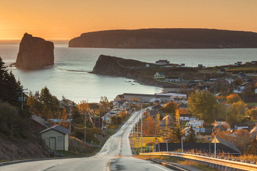 CA04249 Canada, Quebec, Gaspe Peninsula, Perce, elevated view of town and Perce Rock from Rt 132, dawn