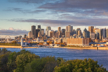 CA04291 Canada, Quebec, Montreal, elevated city skyline from the St. Lawrence River, dawn