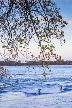 CA04300 Canada, Quebec, Montreal, St. Lawrence River, wave surfer, dusk